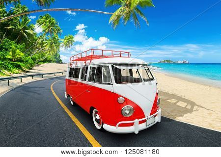 Retro beach van. Vintage bus in the beach on the background of palm trees.The concept of travel