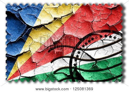 Postal stamp: Grunge seychelles flag with some cracks and vintage look