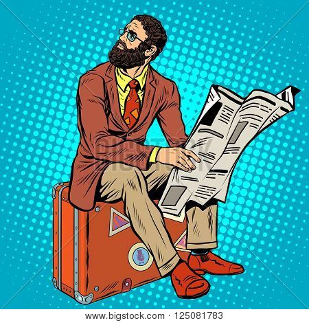 Bearded hipster traveler reading a newspaper pop art retro style. Retro hipster sitting on a suitcase. Bearded businessman