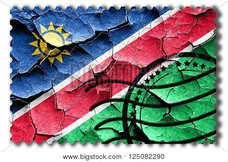 Postal stamp: Grunge Namibian flag with some cracks and vintage look