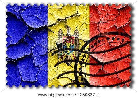 Postal stamp: Grunge Moldova flag with some cracks and vintage look