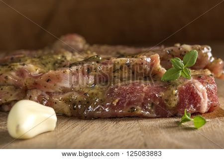 Raw pork neck meat with spices ready for barbeque