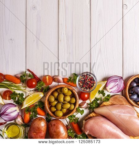 Chicken breast with fresh vegetables and spices for cooking. Healthy or diet food concept.