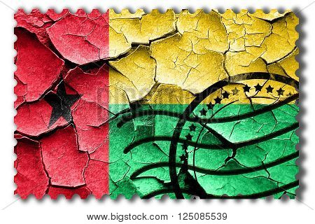 Postal stamp: Grunge Guinea bissau flag with some cracks and vintage look