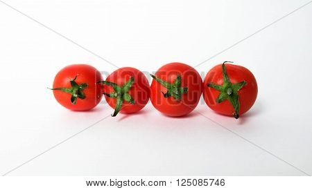 flavored tomato with vitamins on white background