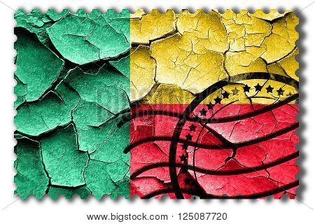 Postal stamp: Grunge Benin flag with some cracks and vintage look