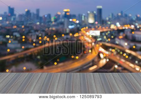 Opeing wooden floor,  Abstract blurred light background, city downtown and highway interchange night view