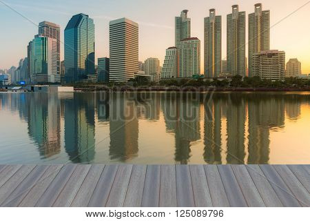 Opening wooden floor, Office building with water reflection view in public park