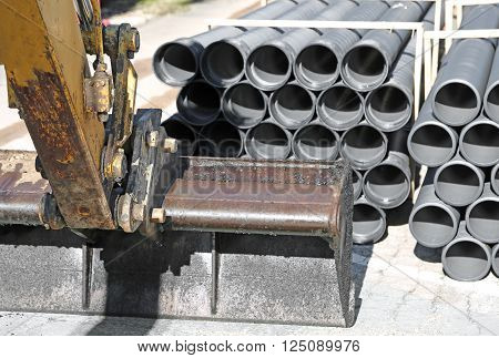 Mechanical Digger Arm With Bucket And Laying Of Optical Fibre Conduits