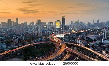 Sunset over Bangkok city downtown background and interchanged expressway, Thailand