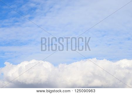Blue sky with clouds may be used as background.