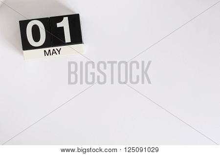 May 1st. Image of may 1 wooden color calendar on white background.  Spring day, empty space for text.  International Workers' Day.