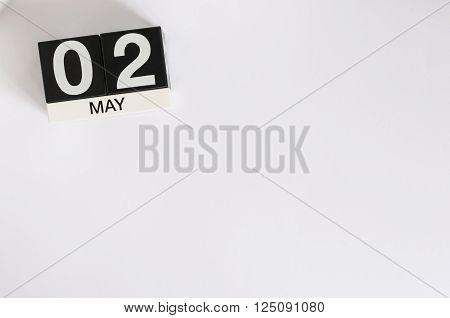 May 2nd. Image of may 2 wooden color calendar on white background.  Spring day, empty space for text.  last spring month.