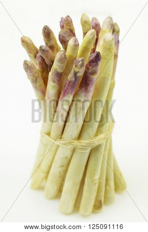 Bunch of fresh white asparagus, on white background.
