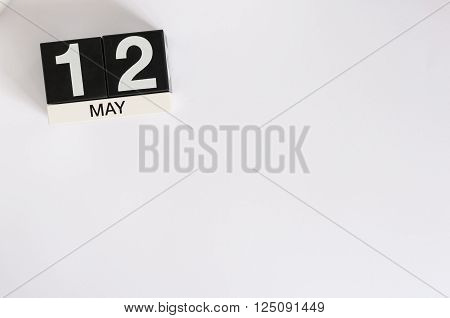 May 12th. Image of may 12 wooden color calendar on white background.  Spring day, empty space for text. International Nurses Day.