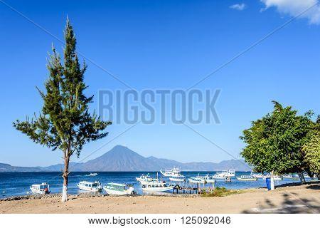 Boats & San Pedro volcano on Lake Atitlan in Guatemalan highlands