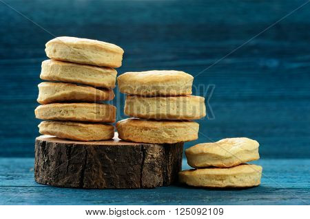 Homemade imperfect cookies in piles on deep blue background