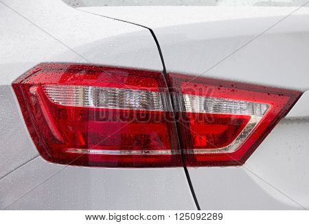 Close up of new white car tail light