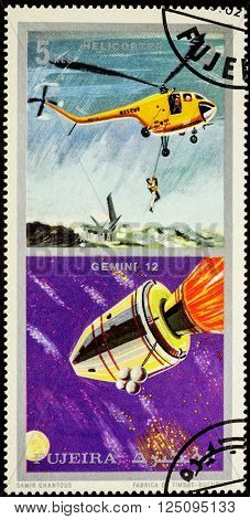 MOSCOW RUSSIA - APRIL 07 2016: A stamp printed in Fujeira shows spacecraft Gemini 12 and helicopter series