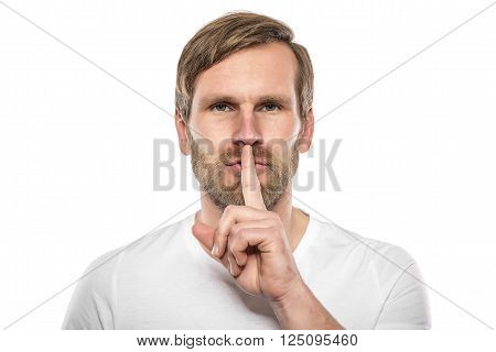 Man silent quiet gesture with finger. Isolated on white.