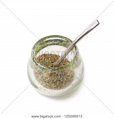 Glass mate calabash vessel with a dry mate tea leaves and bombilla drinking straw inside it, composition isolated over the white background