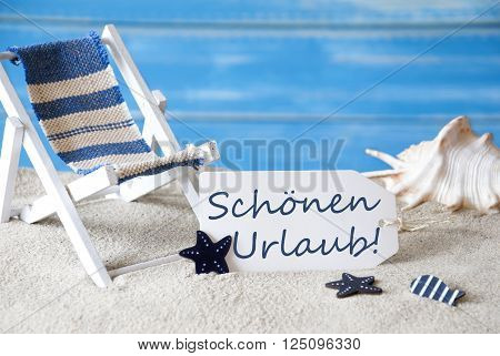 Summer Label With German Text Schoenen Urlaub Means Happy Holiday. Blue Wooden Background. Card With Holiday Greetings. Beach Vacation Symbolized By Sand, Deck Chair And Shell.