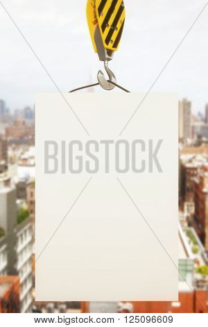 Blank poster on crane hook with cityscape in the background. Mock up 3D Rendering