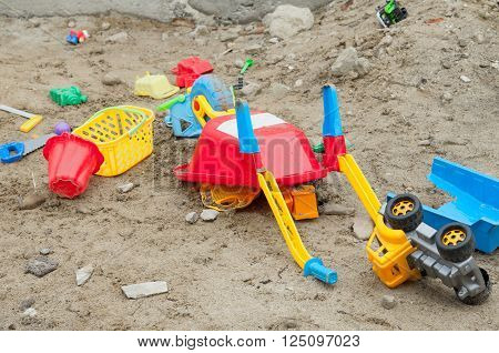 sand toys in a sandbox. A close up
