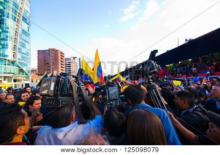 Quito, Ecuador - April 7, 2016: Group of people Holding protest signs, balloons with police and journalists during anti government protests in Shyris Avenue.