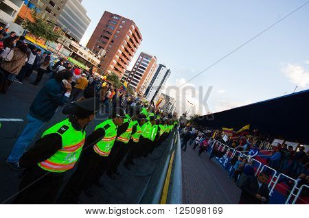 Quito, Ecuador - April 7, 2016: Police awaiting overlooking peaceful anti tax march in Shyris Avenue. Anti Rafael Correa goverment protestors.