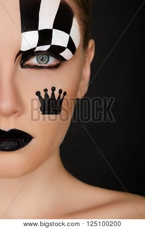 woman with black and white face art on black background