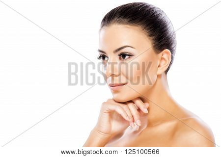 Head and shoulders portrait of beautiful model on white background