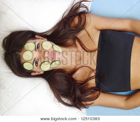 cucumbers circles on a girl face