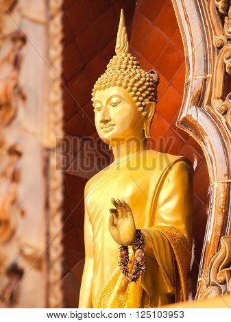Standing Buddha status . Buddha image style pagoda.