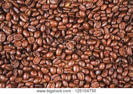 Saturated coffee bean background, close - up