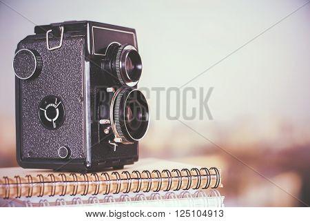 Closeup of retro camera on spiral copybooks