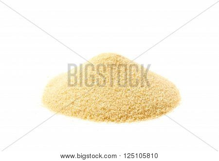 Pile of stevia cane sugar isolated over the white background
