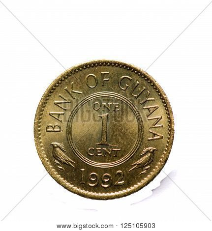 metal coins one cent Guyana  isolated on white background .