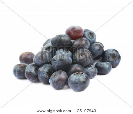 Pile of ripe bilberries isolated over the white background ** Note: Shallow depth of field