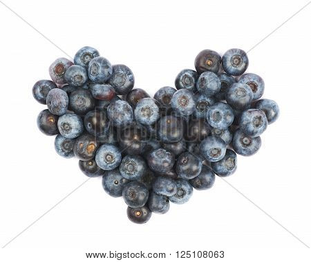 Heart shape made of bilberries isolated over the white background
