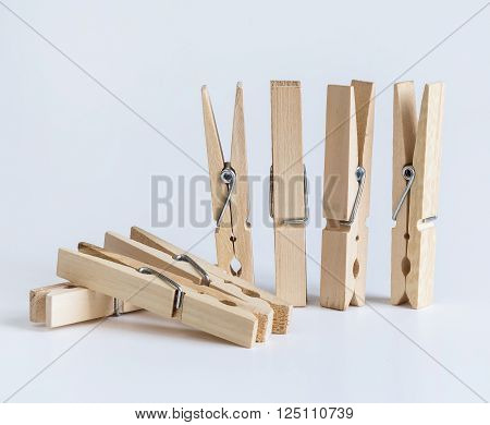 Wooden clothespins on a white background close-up tools