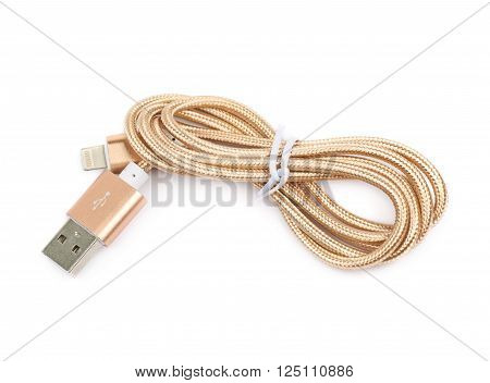 Folded USB lightning golden cable isolated over the white background