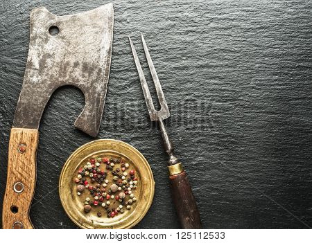 Kitchen utensils on the graphite background.