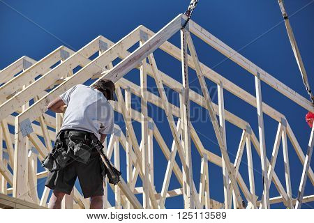 man working construction home building industry carpentry and sitework details in progress