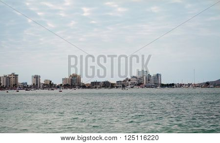 Salinas, Ecuador - March 22, 2016: Waterfront skyline view of beautiful Salinas with buildings stretching alongside beach.