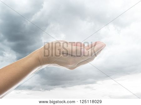 Empty-hand human to pray with sky background.