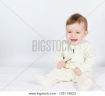 Little  Baby Funny Boy In Suit Sitting.