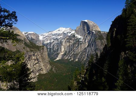 Half Dome in Yosemite National Park in Spring with blue sky