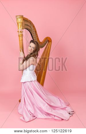portrait of a girl with a harp