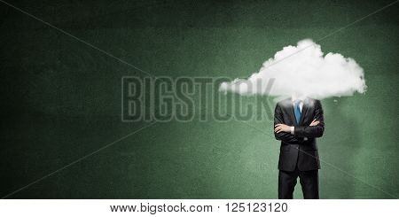 Businessman with arms crossed on chest and head in cloud